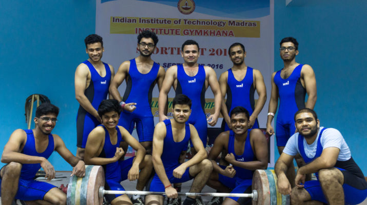 The whole team showing off their muscular prowess!